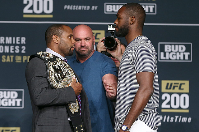 Victorious Jon Jones kisses defeated rival Daniel Cormier after UFC 214